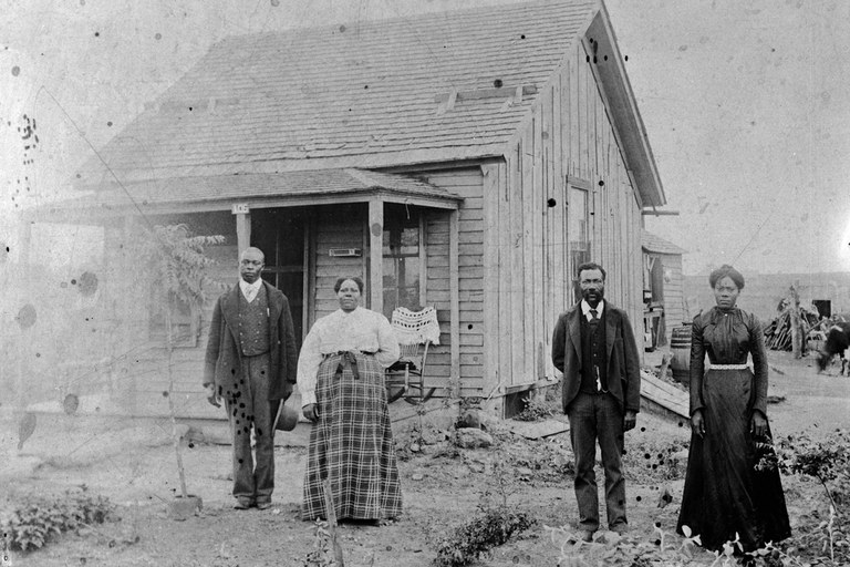 "Settlers in Nicodemus, Kansas. Many African Americans, called ""Exodusters,"" fled the horrible Reconstruction South with the hope for better opportunities there. - Wikicommons"