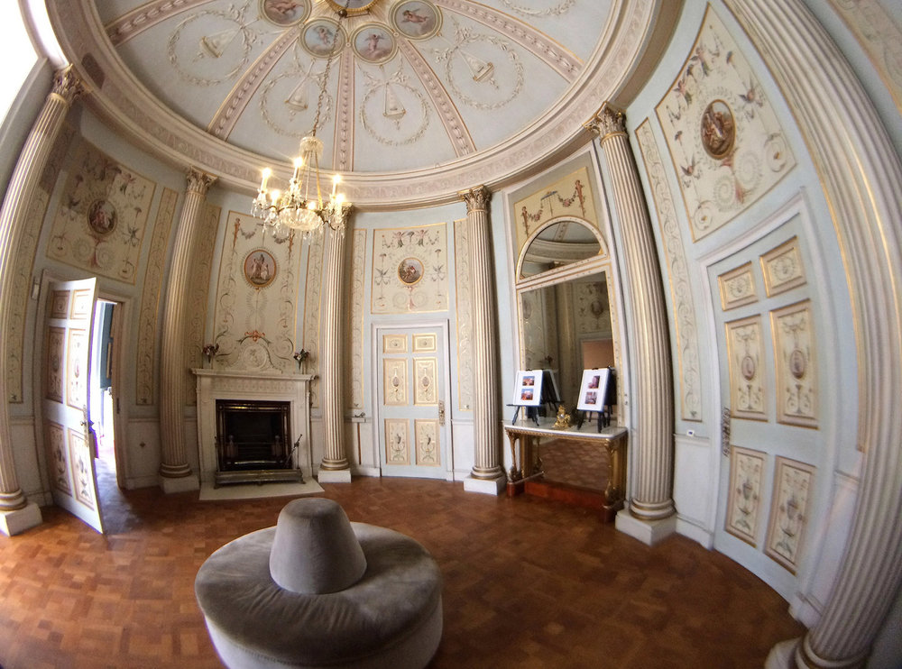 Fisheye lens attached, distorting the vertical columns in an already round shaped room