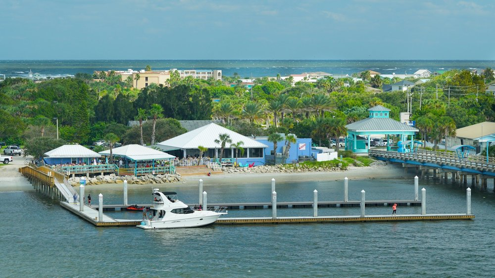 Vilano Beach, FL - We're located in between the Vilano Bridge and the pier. We offer plenty of parking and a large dock for easy boat access.