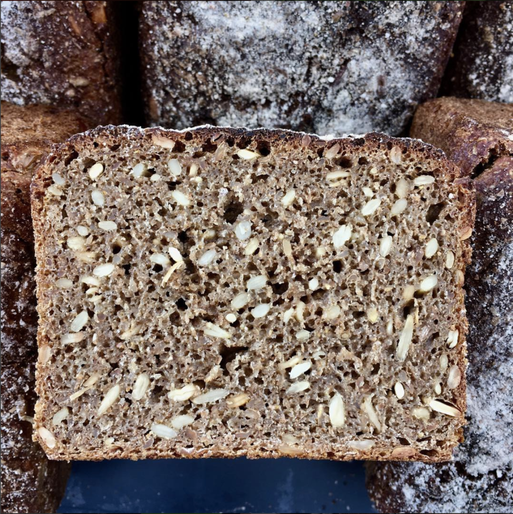 100% rye Vollkornbrot - This German heritage loaf is a labour of love. We mature the rye sourdough starter and soak chopped whole rye grains and sunflower seeds in water and a dash of molasses for 18 hours - before even making the dough.Slice very thinly and enjoy with cheese, smoked meats and fish.(Wholegrain Rye Sourdough) (1200g. Rye (gluten), sunflower seeds, molasses, salt)