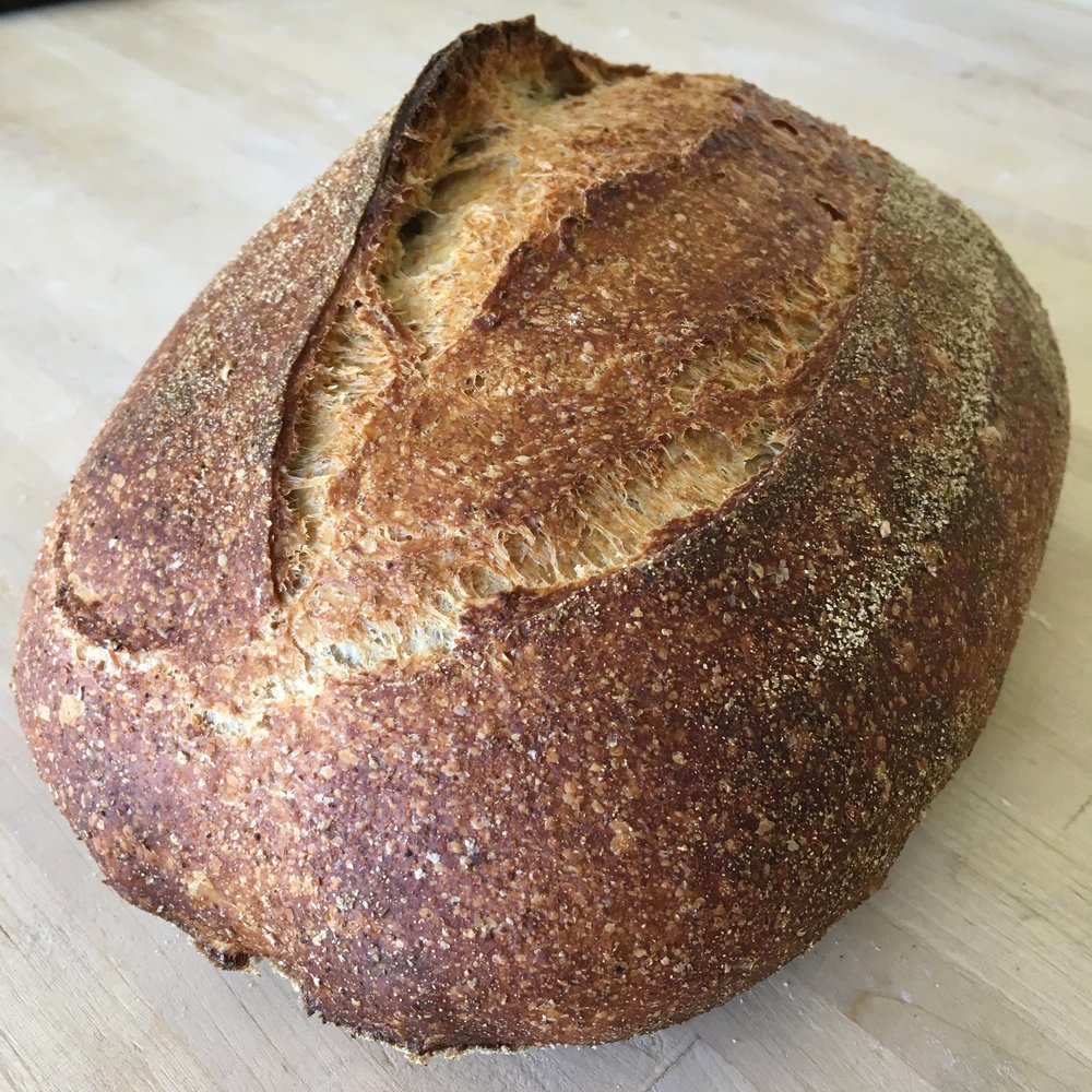 Mach Sourdough - Packed full of flavour for satisfying sandwiches and incredible toast. From first feeding our starter to baking the finished loaf it's approximately 24 hours in the making. 70% stoneground organic white flour, 30% wholemeal flour grown and milled in Wales.(850g. Wheat (gluten), salt)