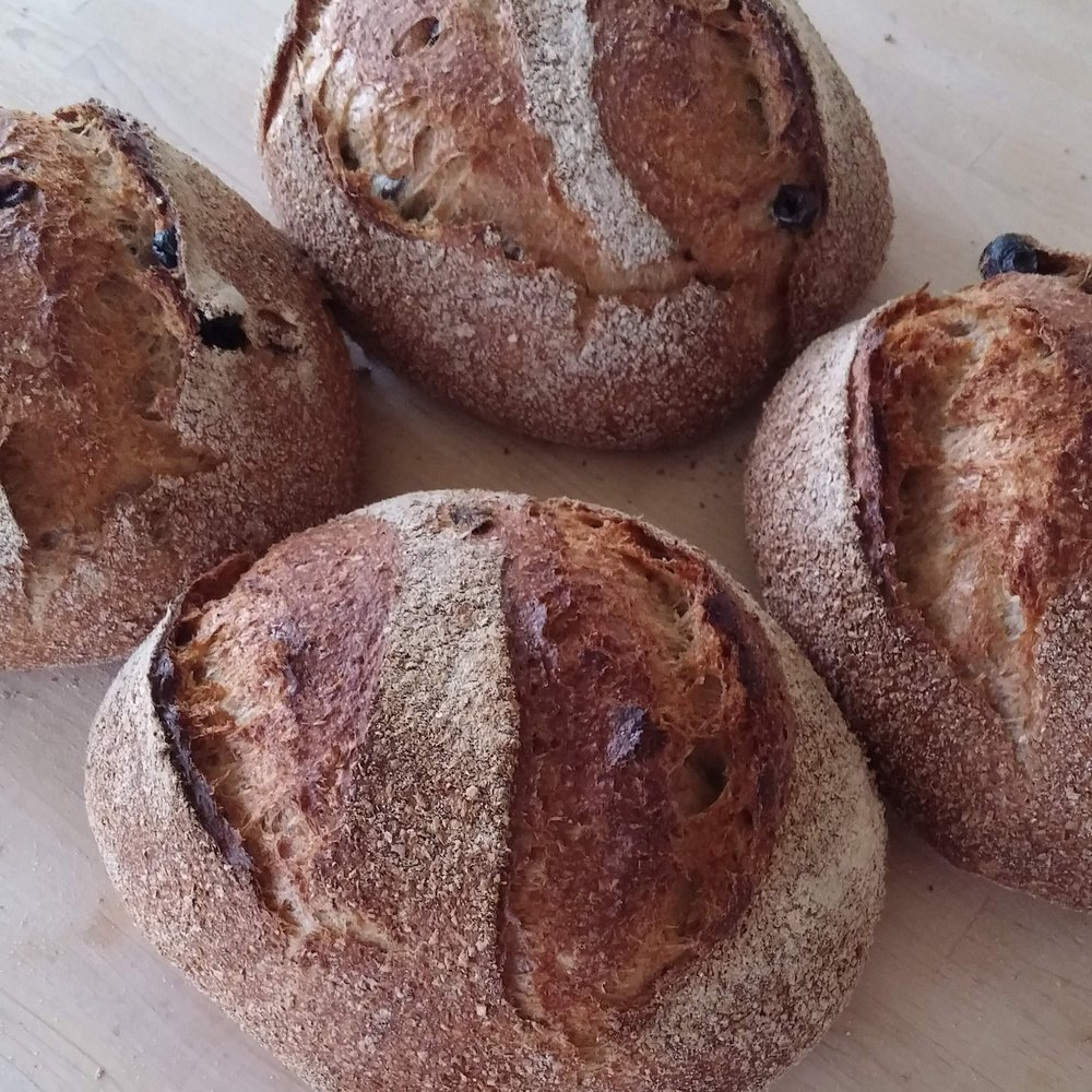 olive mach sourdough - Made with organic Greek Kalamon olives, this loaf is great served on the side with Mediterranean food, and plenty of olive oil to dip it in.(550g. Wheat (gluten), black olives, salt)