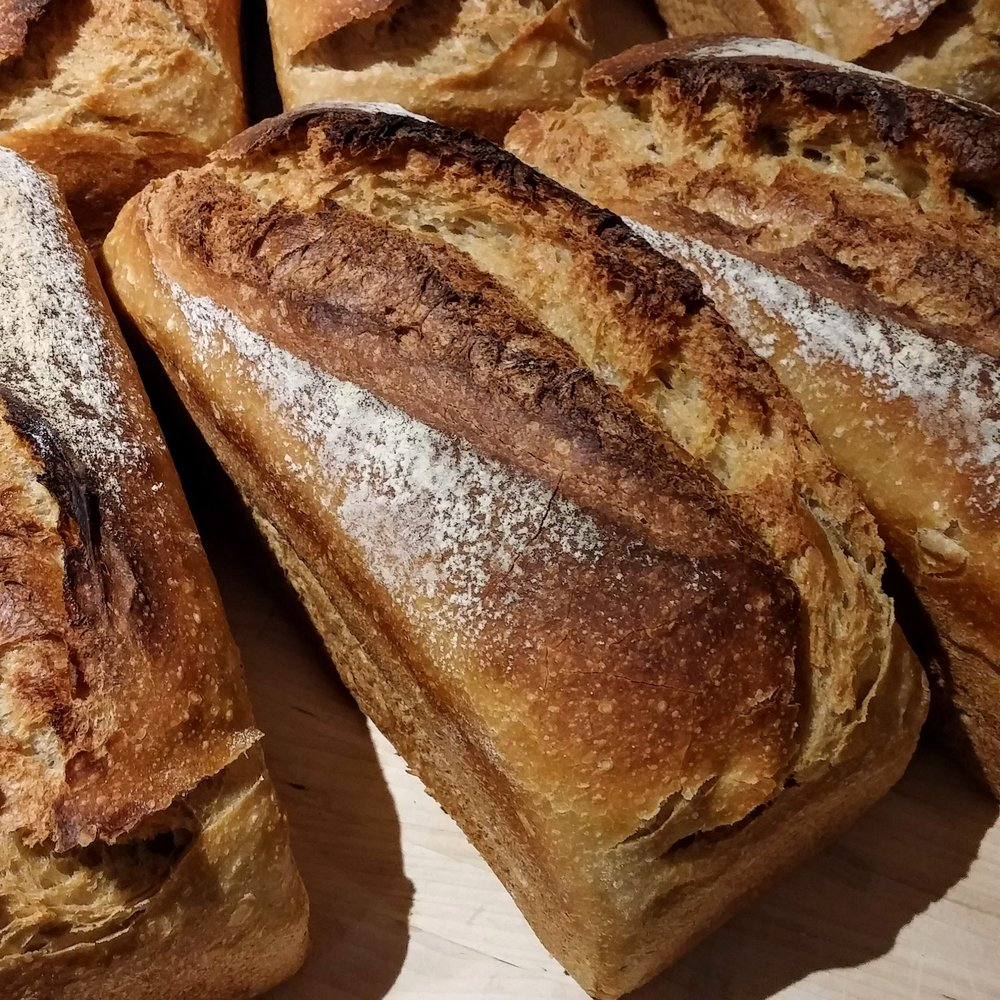 Y Gwyn Gymreig - A beautifully white and 100% Welsh loaf. Using grain grown in Powys, stone milled and sieved in Ceredigion, and baked at our bakery near Machynlleth. Soft and light inside with a caramelised top crust, baked in a tin.(850g. Wheat (gluten), salt)