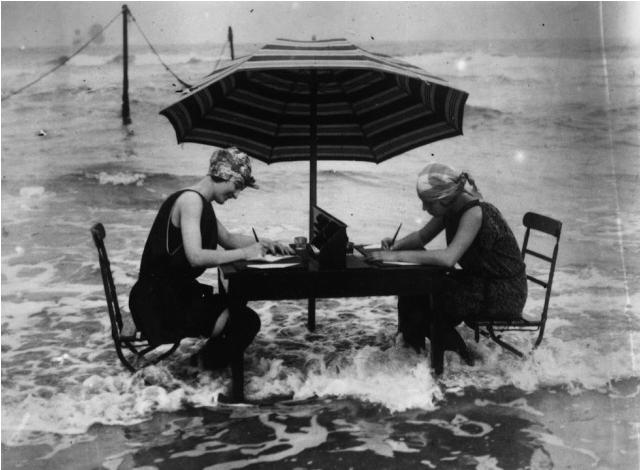 women-writing-shore.png