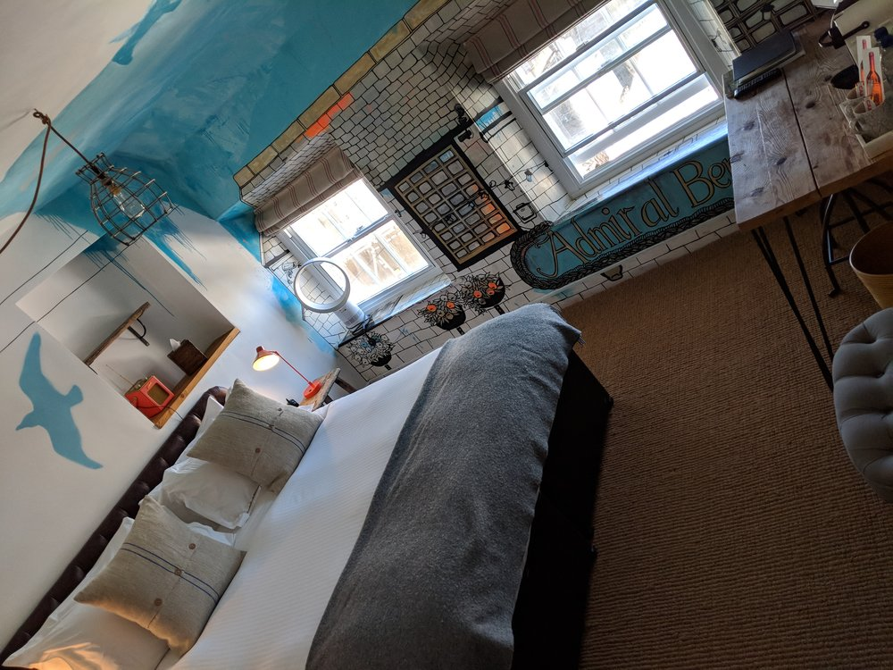 The Artist Residence's thing is that each of the rooms has a distinct theming based on the area completed by a local artist. Ours was an interpretation of the Admiral Benbow Inn just across the road framed with blue skies and seagulls which move from the walls onto the ceilings