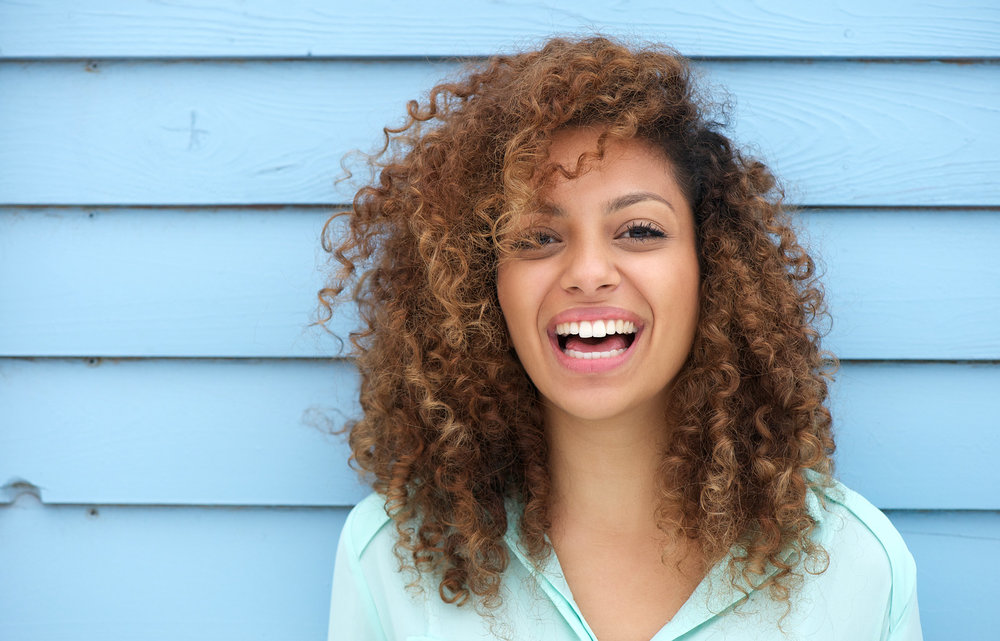 Girls smiling with hearing aids.jpg