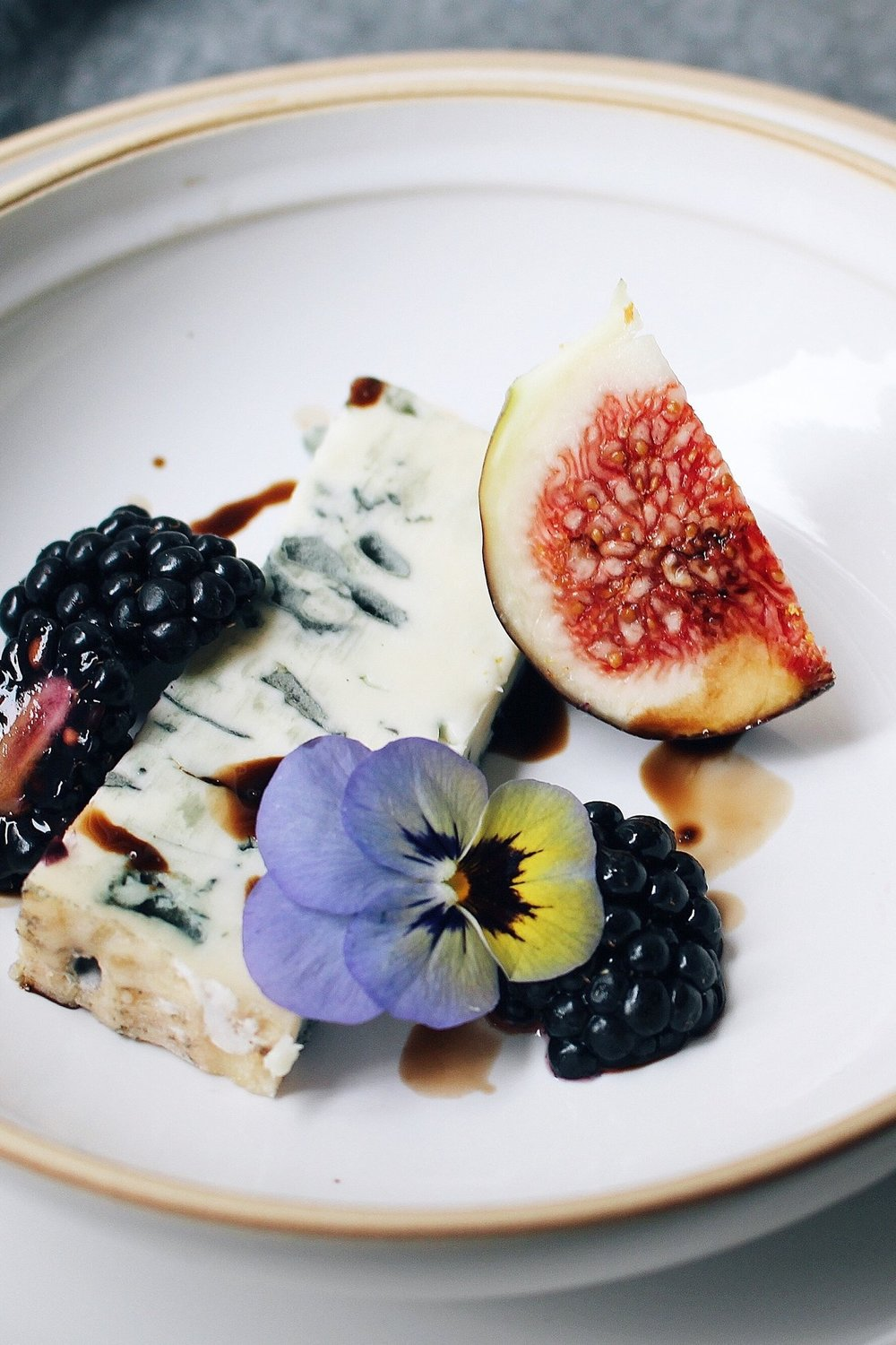 Gorgonzola, blueberries, fig, edible flower, balsamic vinegar reduction.
