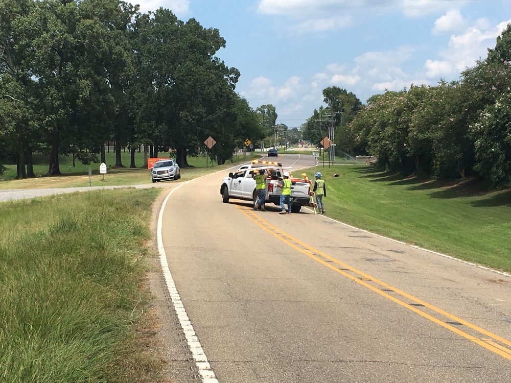 """The last """"bridge closed"""" sign on Bluff Road comes down at 2:30 pm, Tuesday, July 25, 2018."""