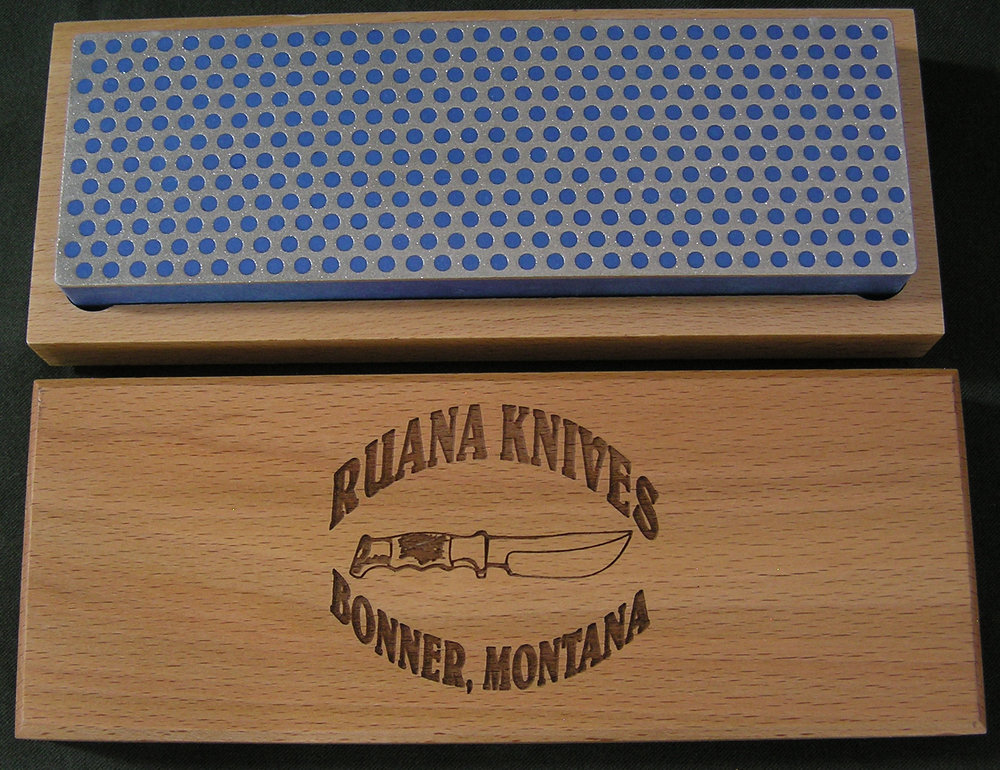 Knife Collector's Sharpening Stone - In conjunction with Diamond Machining Technology (DMT®) we are offering the Ruana Knife Collector's Sharpening Stone. This is the same high quality, Made in America, bench stone that we've offered for several years, but it's now available with our logo handsomely engraved on a beautiful hardwood display case. This must item for any Ruana Knife collection is available in a 6