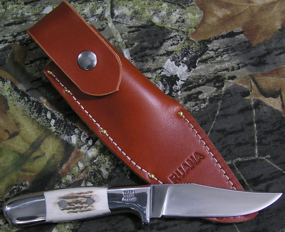 "Honoring, our father, Vic Hangas - In 2017, we honored our dad, Vic Hangas, and his 52 plus years of making Ruana Knives with the V. N. Hangas Special knife. The prototype and first 100 of these knives were made with special engraving, numbering, a certificate, special leather for the sheath and other bells and whistles that will never be used again for this knife and sheath. We anticipated this design being popular and are offering it for sale as a non-catalog, but regular production knife.Knife & Sheath Features:The blade is hammer forged, flat grind 4"" 1095 carbon steel blade made from 3/16"" stock with a hybrid shape between the Custom Finn and Steelhead blades. It has thumb notches at the hilt and would work well for hunting, fishing, camping, anything in the outdoors or an everyday carry knife.The 4 ½"" cast aluminum handle has elk antler inserts secured with aluminum rivets and is a shop favorite of all of us in terms of comfort and functionality.The boot style, full sheath is handmade in our shop with chestnut colored English Bridle leather.Vic's Blade ~ $450"