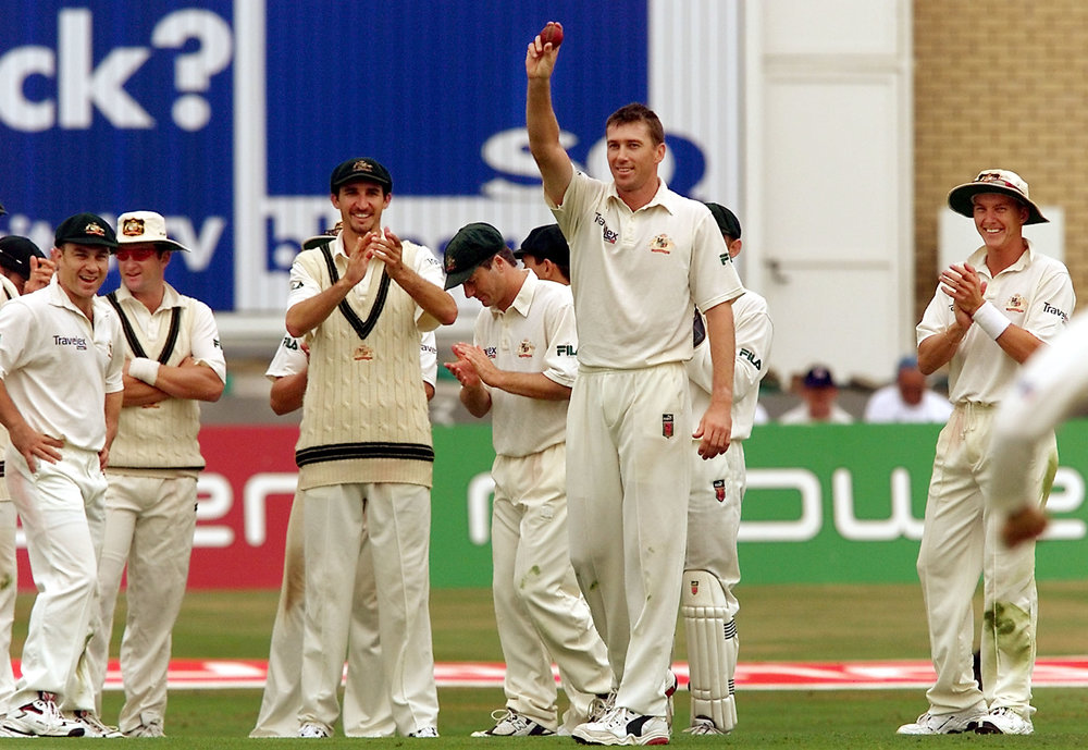 Australian paceman Glenn McGrath holds the ball aloft after snaring a five wicket haul against England on the first day of the third Test Match at Trent Bridge in Nottingham 02 August 2001