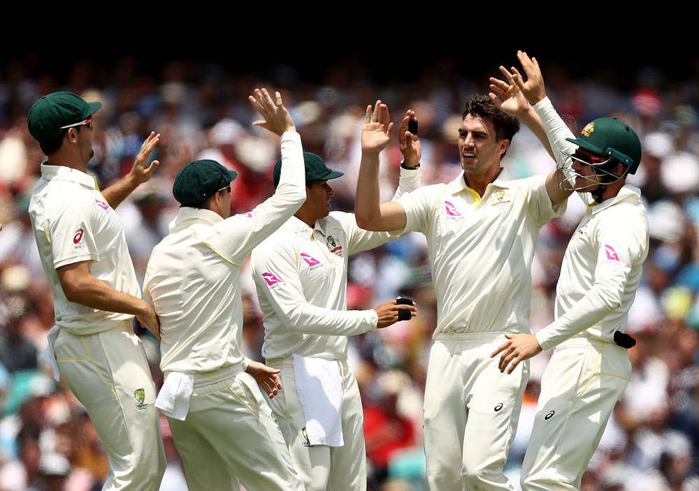 Pat Cummins celebrates after taking the wicket of Mark Stoneman of England during day one of the Fifth Test match in the 2017/18 Ashes Series