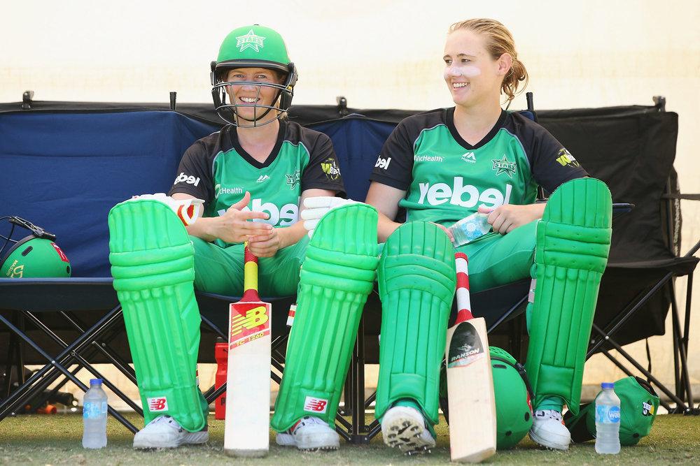 Meg Lanning of the Stars (L) and her sister Anna Lanning wait to bat during the Women's Big Bash League match between the Melbourne Stars and the Brisbane Heat
