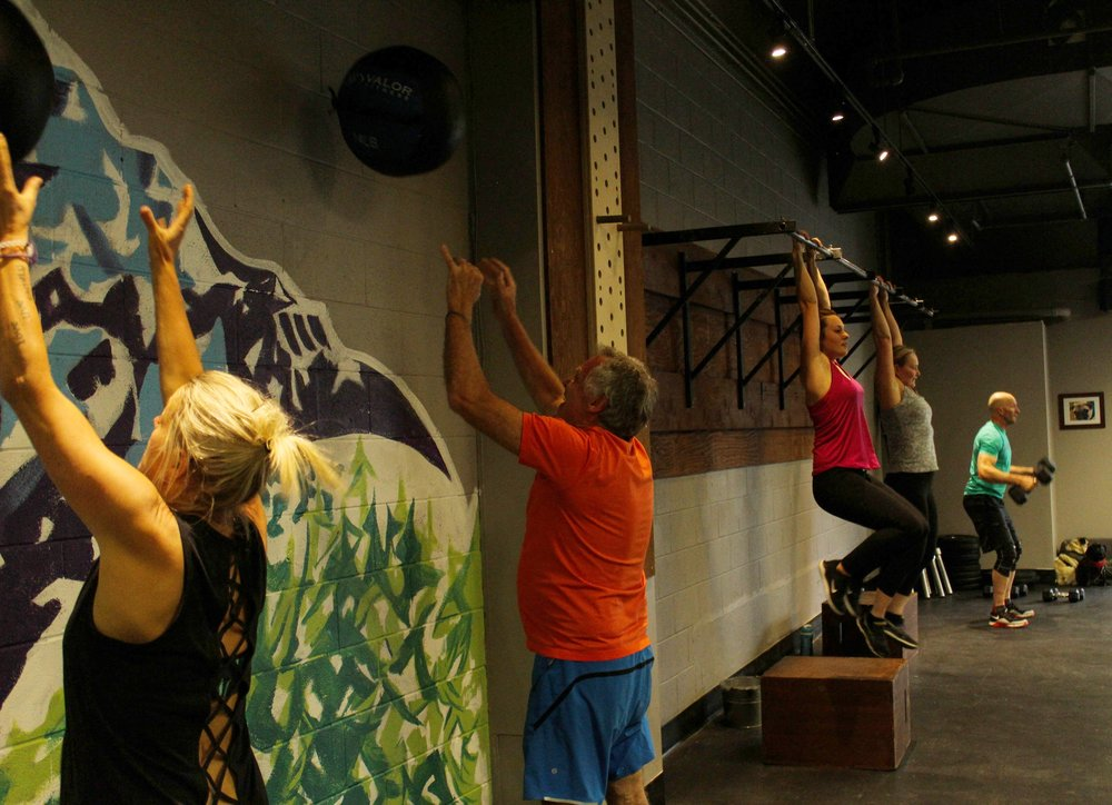 Banff local's enjoying a CrossFit workout in downtown Banff.