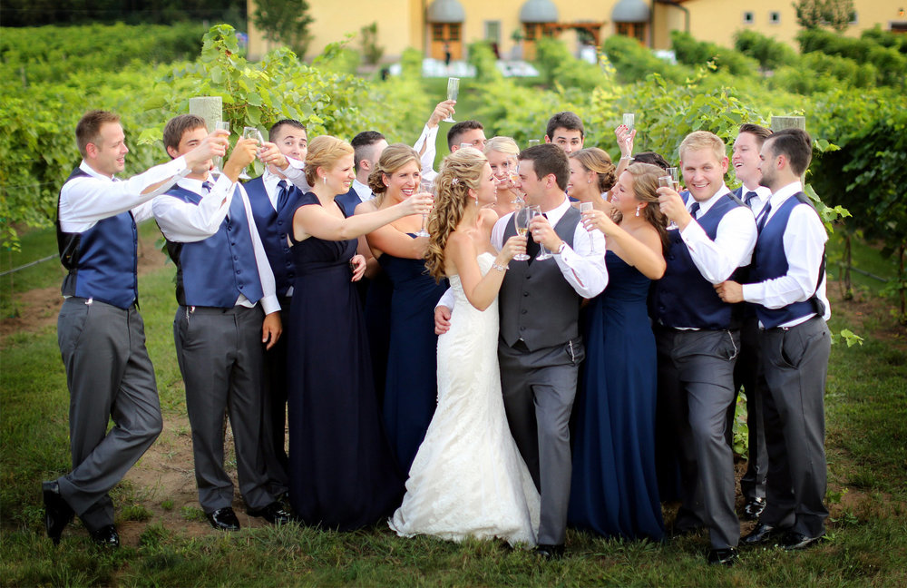 12-Lake-Pepin-Wisconsin-Wedding-Photography-by-Vick-Photography-Villa-Bellezza-Vineyard-Winery-Toasting-Wedding-Party-Emily-&-Sam.jpg