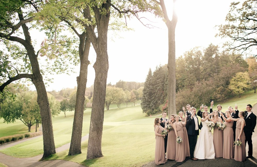 11-Minneapolis-Minnesota-Wedding-Photography-by-Vick-Photography-Woodhill-Country-Club-Golf-Course-Wedding-Party-Toasting-Elle-and-Tyler.jpg