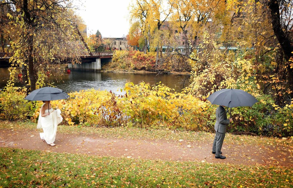 01-Minneapolis-Minnesota-Wedding-Photography-Downtown-Rain-Nicollet-Island-Pavilion-Fall-Colors-Fall-Leaves-Autumn-First-Look-Kalley-and-Ben.jpg