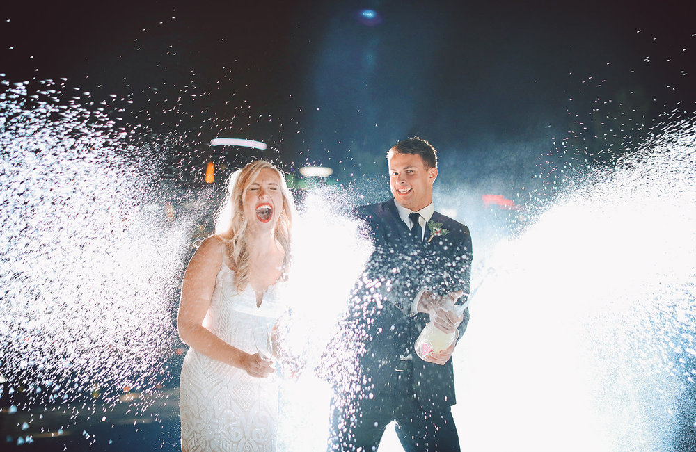 04-Wedding-Photography-by-Vick-Photography-Champagne-Cheers-Spray-Night.jpg