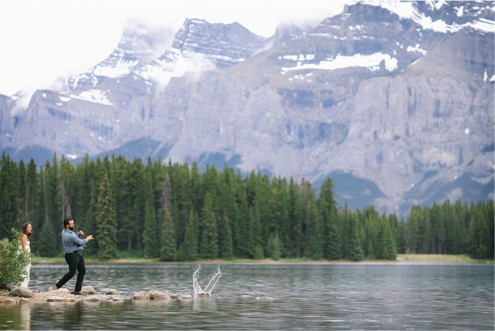 06-Banff-Canada-Engagement-Photography-by-Vick-Photography-Lake-Louise-Mountains-Rock-Skipping-Lizz-and-Brady.jpg