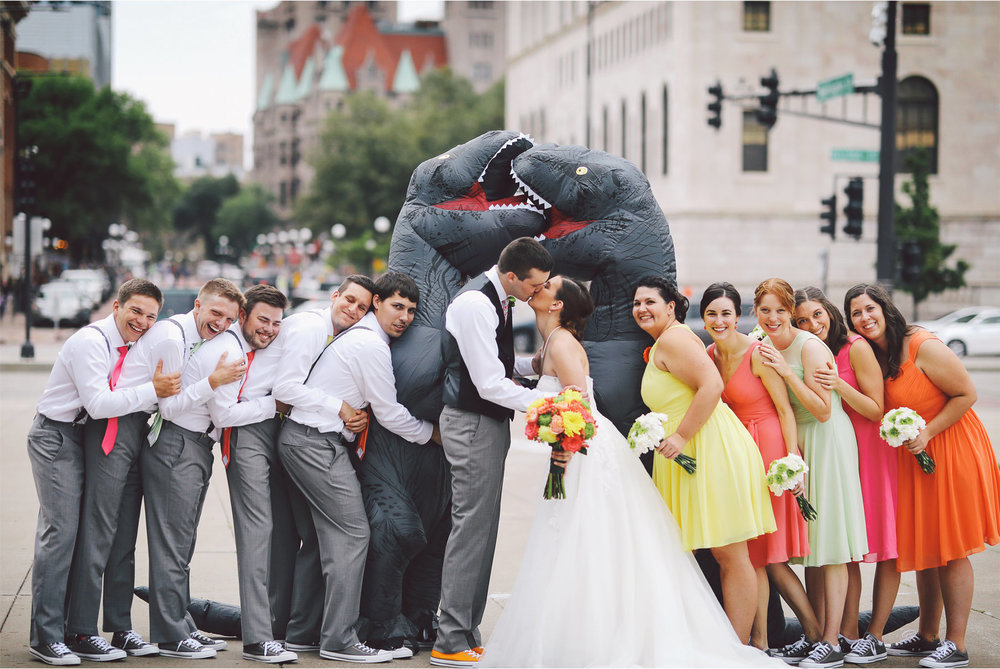 10-St-Paul-Minnesota-Wedding-Photography-by-Vick-Photography-Science-Museum-Dinosaur-Wedding-Group-Wedding-Party-Dinosaur-Kiss-Stephanie-and-Scott.jpg