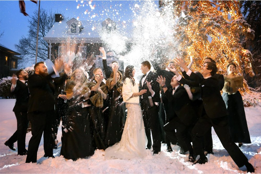20-Saint-Paul-Minnesota-Wedding-Photography-by-Vick-Photography-Wedding-Party-Group-Snow-Ball-Fight-Winter-Wedding-Sami-and-Nick.jpg
