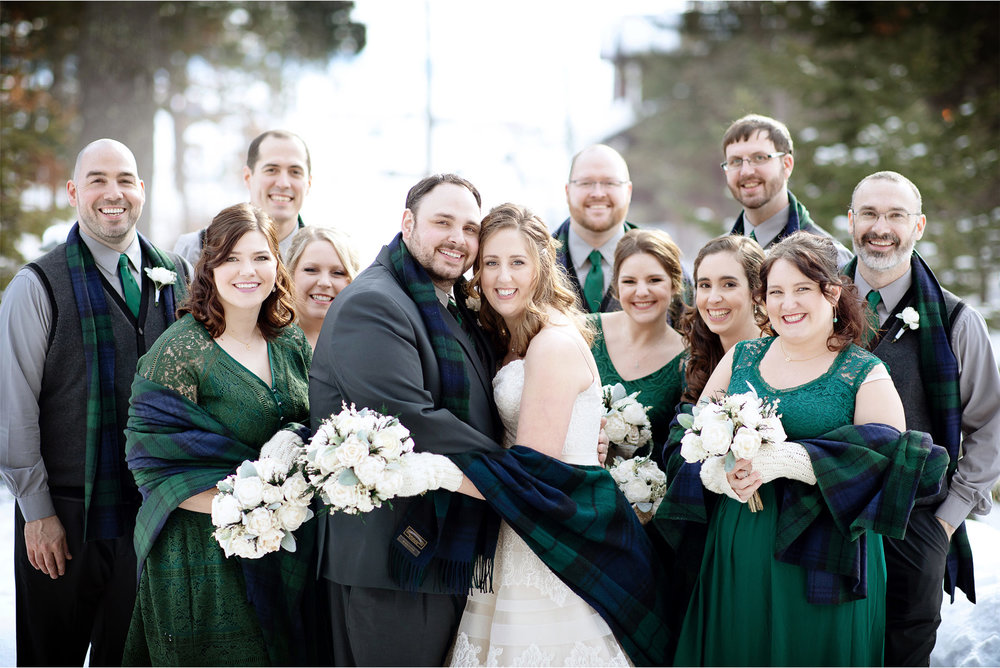 06-Brainerd-Minnesota-Wedding-by-Andrew-Vick-Photography-Nisswa-Grandview-Lodge-Winter-First-Look-Scarf-Plaid-Green-Group.jpg