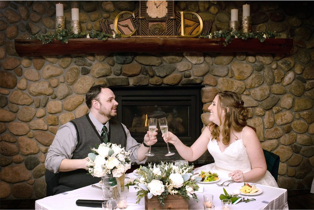 17-Brainerd-Minnesota-Wedding-by-Andrew-Vick-Photography-Nisswa-Grandview-Lodge-Reception-Toast-Bride-Groom.jpg