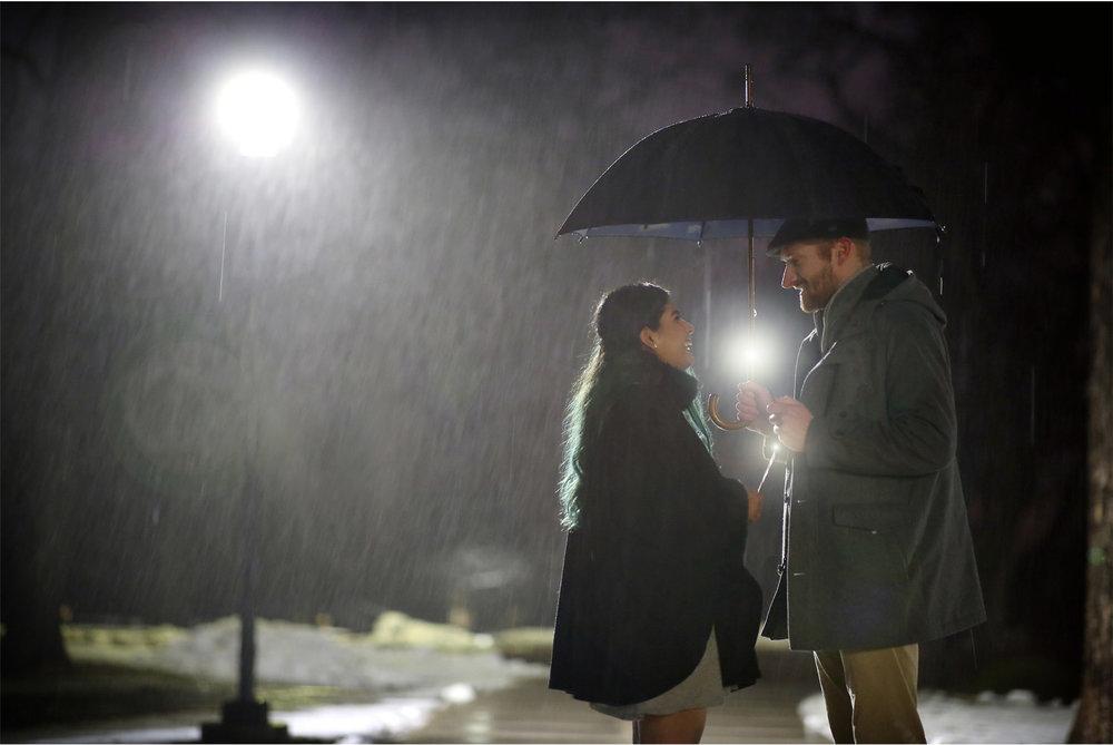 11-Harry-Potter-Themed-Engagement-Session-Minnesota-Wedding-Photography-Andrew-Vick-Night-Rain-Glowing-Wands-Elena-and-Doug.jpg