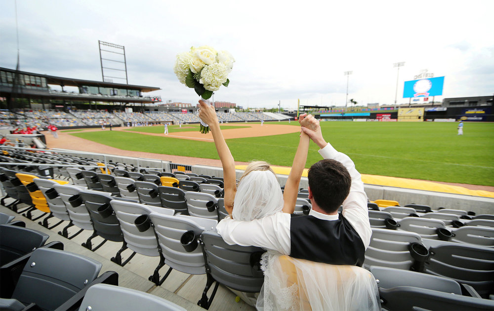 18-Saint-Paul-Minnesota-Wedding-Photographer-by-Andrew-Vick-Photography-Summer-CHS-Field-Stadium-Bride-Groom-Dress-Baseball-Saints-Cheering-Flowers-Laura-and-Tim.jpg