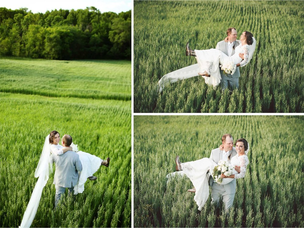 22-South-Haven-Minnesota-Wedding-Photographer-by-Andrew-Vick-Photography-Summer-Tomala-Farm-Field-Bride-Groom-Carry-Flowers-Dress-Vintage-Renee-and-Bobb.jpg