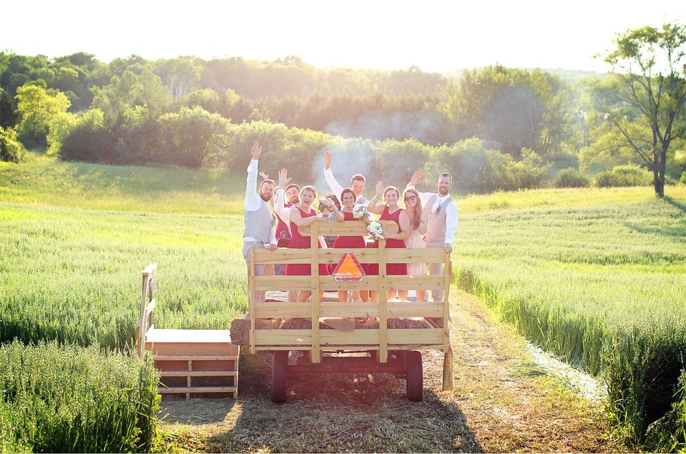 28-South-Haven-Minnesota-Wedding-Photographer-by-Andrew-Vick-Photography-Summer-Tomala-Farm-Field-Bride-Groom-Bridal-Party-Tractor-Trailer-Renee-and-Bobb.jpg