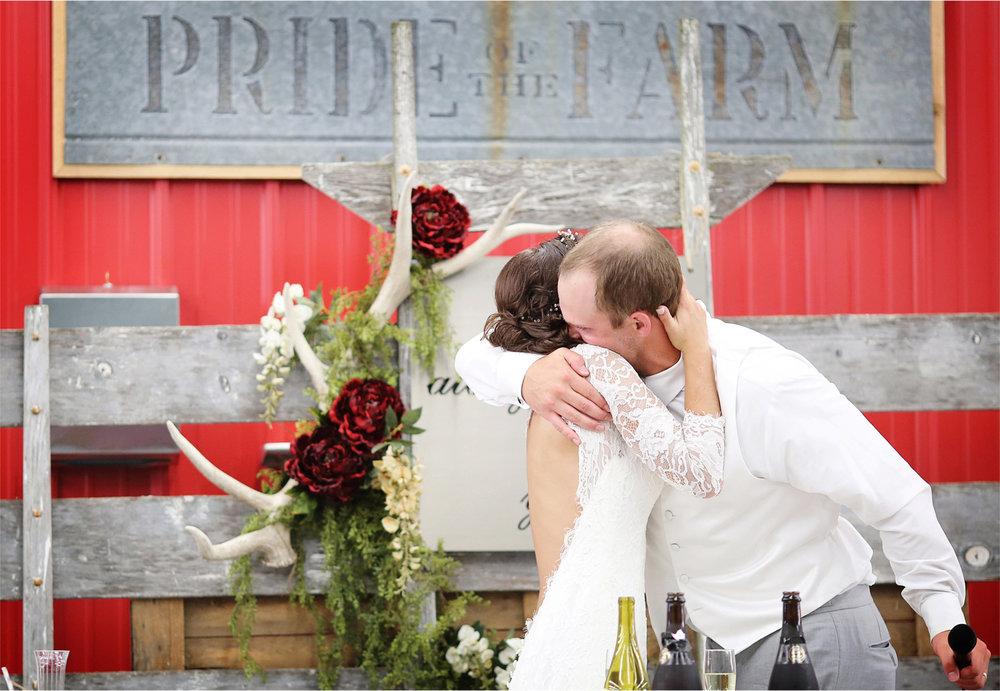 33-South-Haven-Minnesota-Wedding-Photographer-by-Andrew-Vick-Photography-Summer-Tomala-Farm-Reception-Speeches-Hug-Embrace-Renee-and-Bobb.jpg