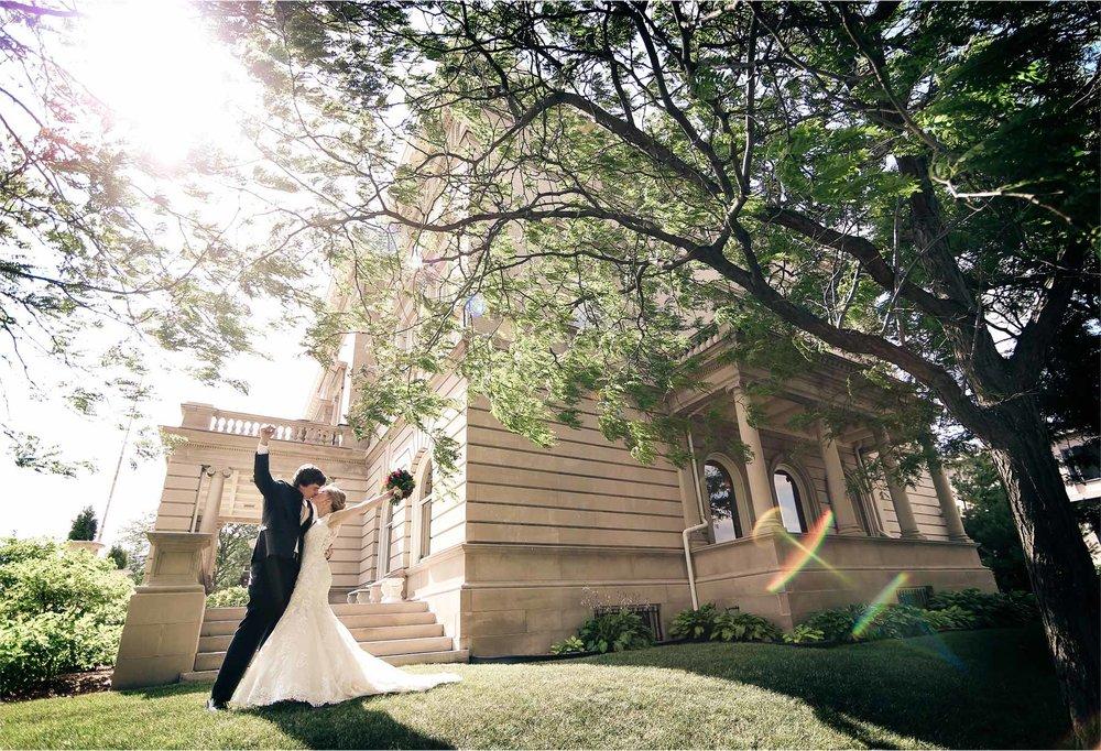 11-Minneapolis-Minnesota-Wedding-Photographer-by-Andrew-Vick-Photography-Summer-Semple-Mansion-Bride-Groom-Kiss-Celebration-Vintage-Stephanie-and-Brady.jpg