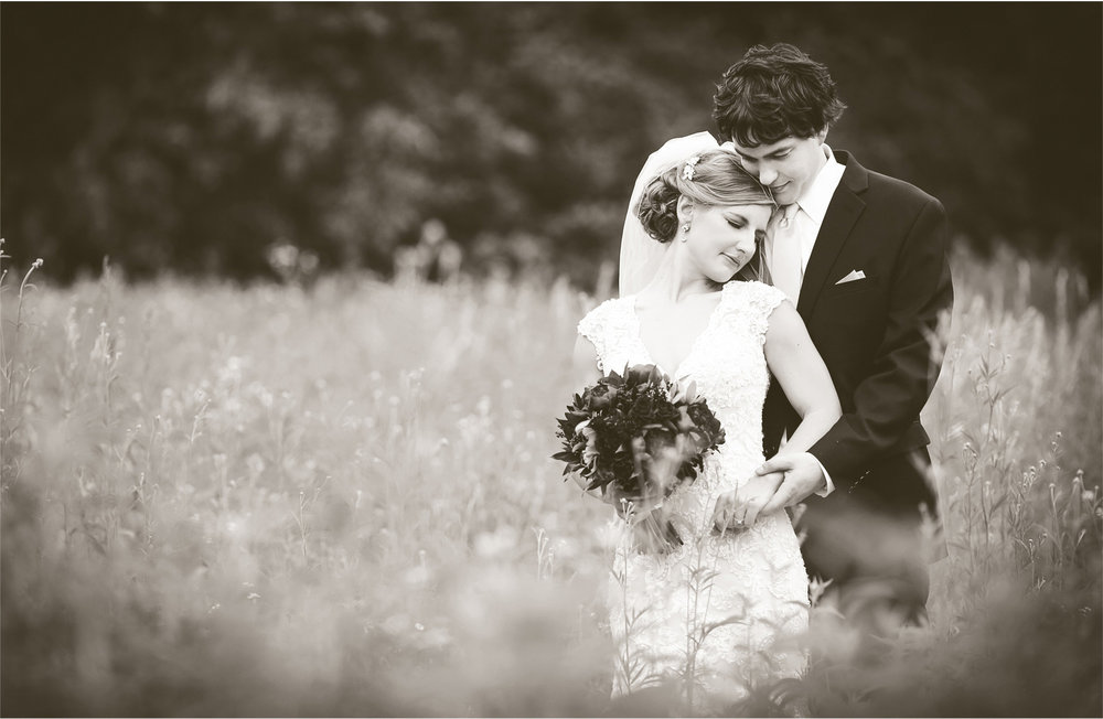 13-Minneapolis-Minnesota-Wedding-Photographer-by-Andrew-Vick-Photography-Summer-Semple-Mansion-Bride-Groom-Embrace-Field-Sepia-Stephanie-and-Brady.jpg