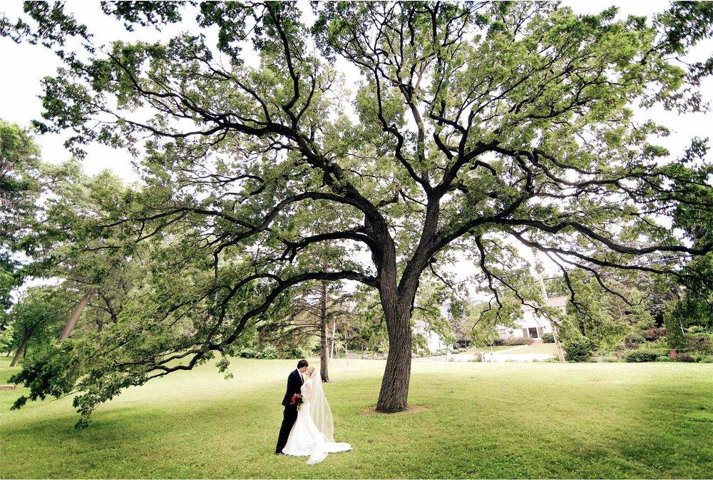14-Minneapolis-Minnesota-Wedding-Photographer-by-Andrew-Vick-Photography-Summer-Semple-Mansion-Bride-Groom-Kiss-Tree-Stephanie-and-Brady.jpg