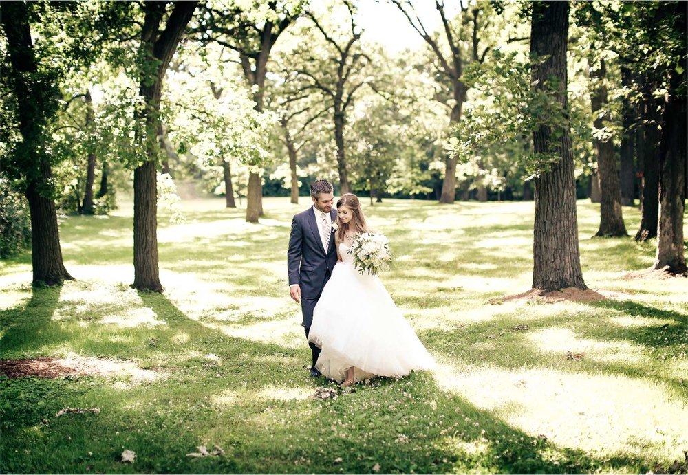 10-Minneapolis-Minnesota-Wedding-Photographer-by-Andrew-Vick-Photography-Summer-Woods-Bride-Groom-Embrace-Vintage-Katie-and-Travis.jpg