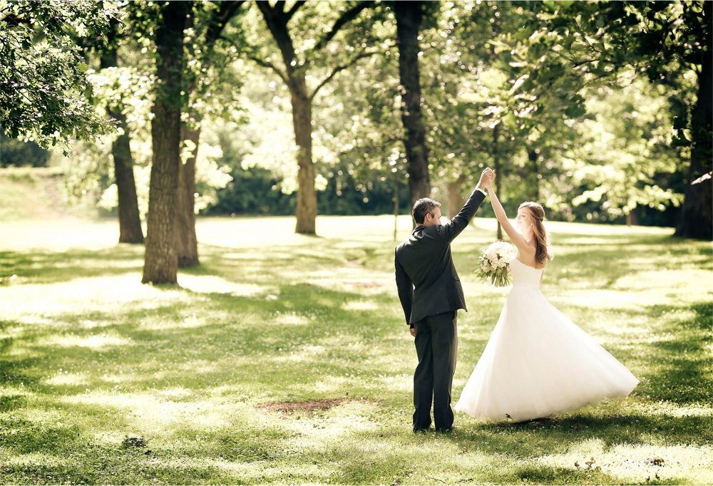11-Minneapolis-Minnesota-Wedding-Photographer-by-Andrew-Vick-Photography-Summer-Woods-Bride-Groom-Dance-Twirl-Vintage-Katie-and-Travis.jpg