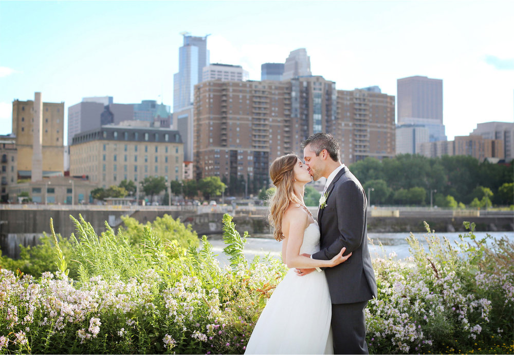 16-Minneapolis-Minnesota-Wedding-Photographer-by-Andrew-Vick-Photography-Summer-Bride-Groom-Kiss-Downtown-Mississippi-River-Katie-and-Travis.jpg