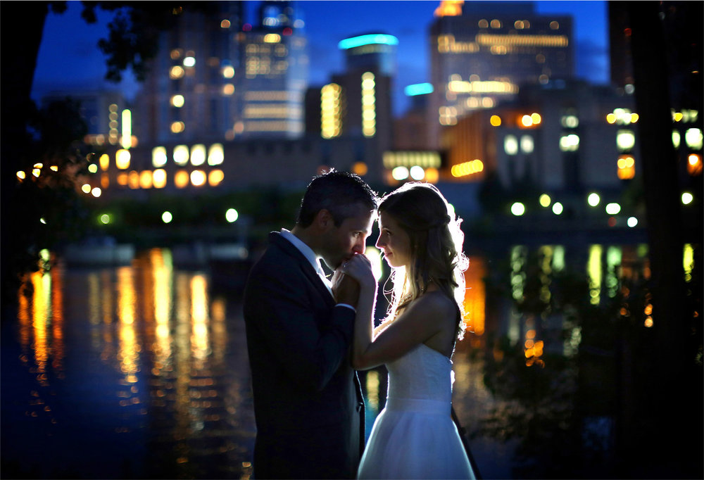 22-Minneapolis-Minnesota-Wedding-Photographer-by-Andrew-Vick-Photography-Summer-Bride-Groom-Nicollett-Island-Pavilion-Embrace-Kiss-Hands-Downtown-Night-Mississippi-River-Katie-and-Travis.jpg