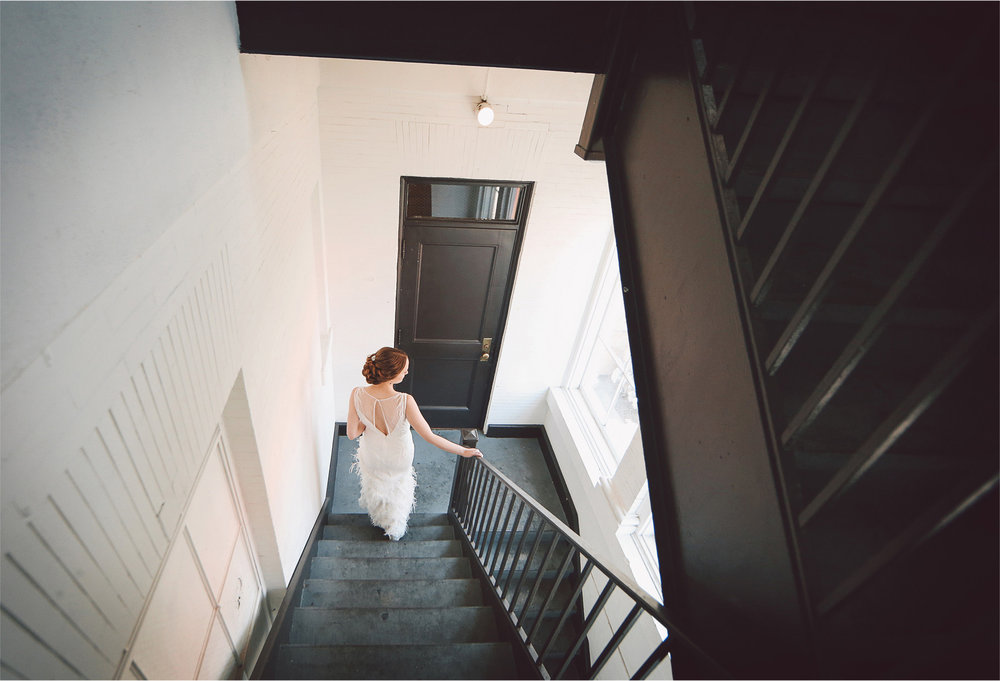 03-Minneapolis-Minnesota-Wedding-Photographer-by-Andrew-Vick-Photography-Summer-Semple-Mansion-Bride-Dress-Feathers-Stairwell-Stairs-First-Meeting-Look-Vintage-Stephanie-and-Robert.jpg