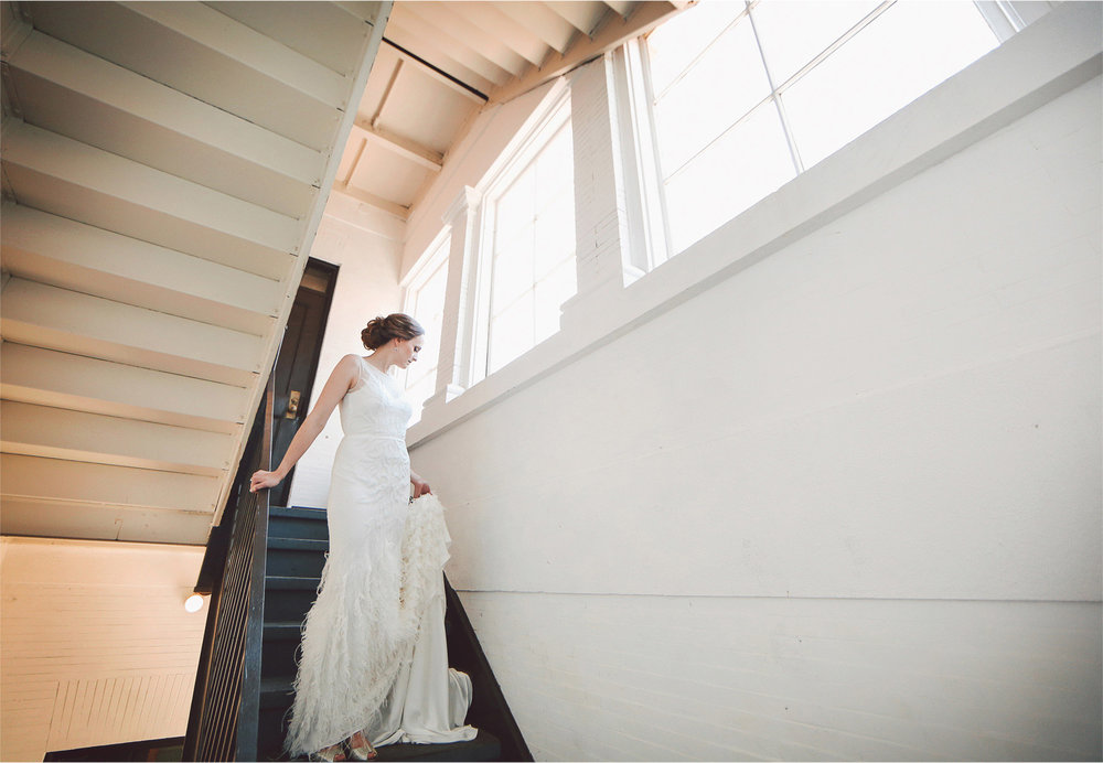 04-Minneapolis-Minnesota-Wedding-Photographer-by-Andrew-Vick-Photography-Summer-Semple-Mansion-Bride-Dress-Feathers-Stairwell-Stairs-First-Meeting-Look-Vintage-Stephanie-and-Robert.jpg