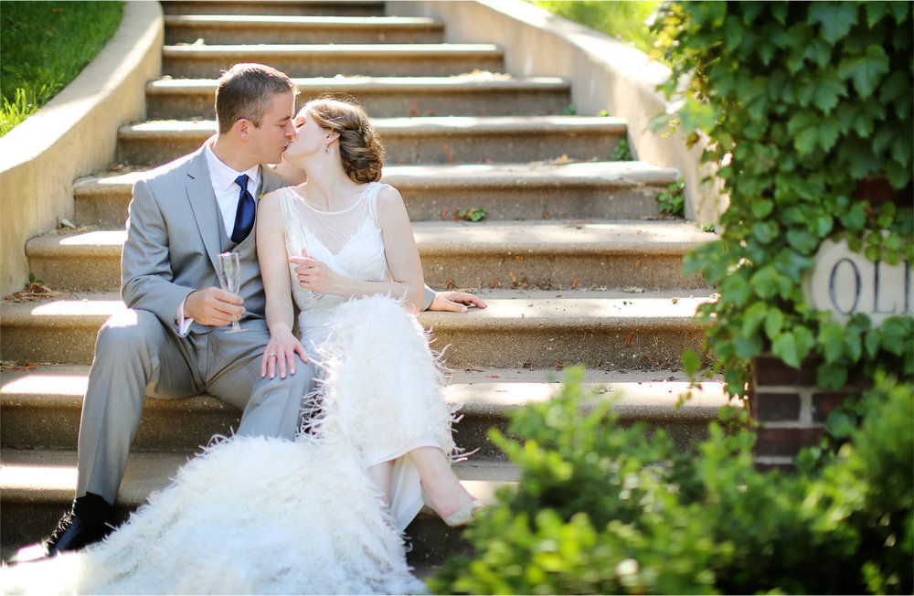 22-Minneapolis-Minnesota-Wedding-Photographer-by-Andrew-Vick-Photography-Summer-Bride-Groom-Kiss-Dress-Feathers-Champagne-Stephanie-and-Robert.jpg