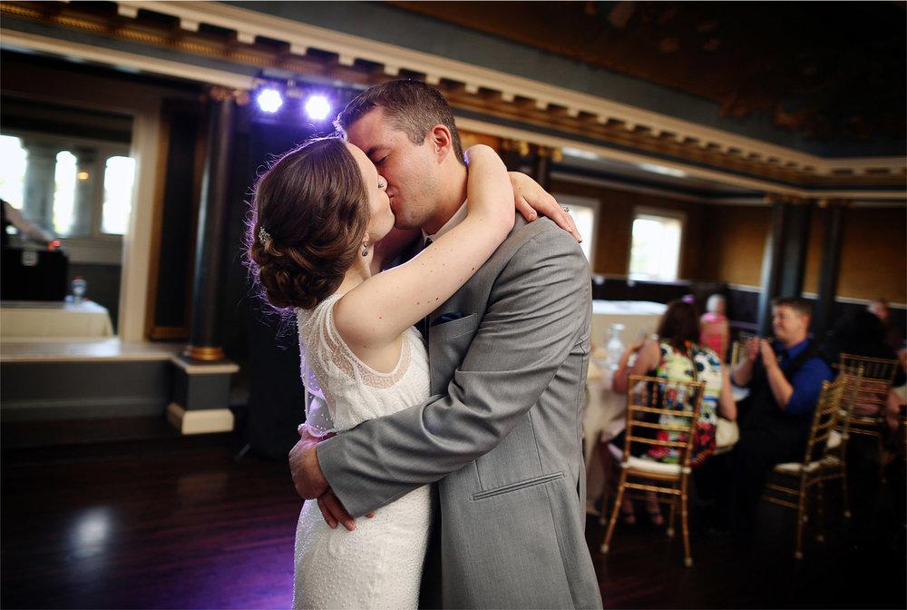 27-Minneapolis-Minnesota-Wedding-Photographer-by-Andrew-Vick-Photography-Summer-Bride-Groom-Reception-Kiss-Dance-Stephanie-and-Robert.jpg