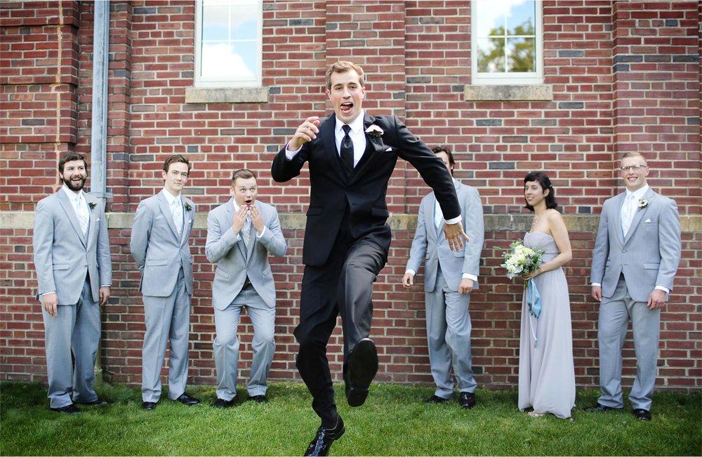 11-Edina-Minnesota-Wedding-Photographer-by-Andrew-Vick-Photography-Summer-Our-Lady-of-Grace-Catholic-Parish-Church-Groom-Jumping-Bridal-Party-Groomsmen-Bridesmaids-Betsy-and-Jon.jpg
