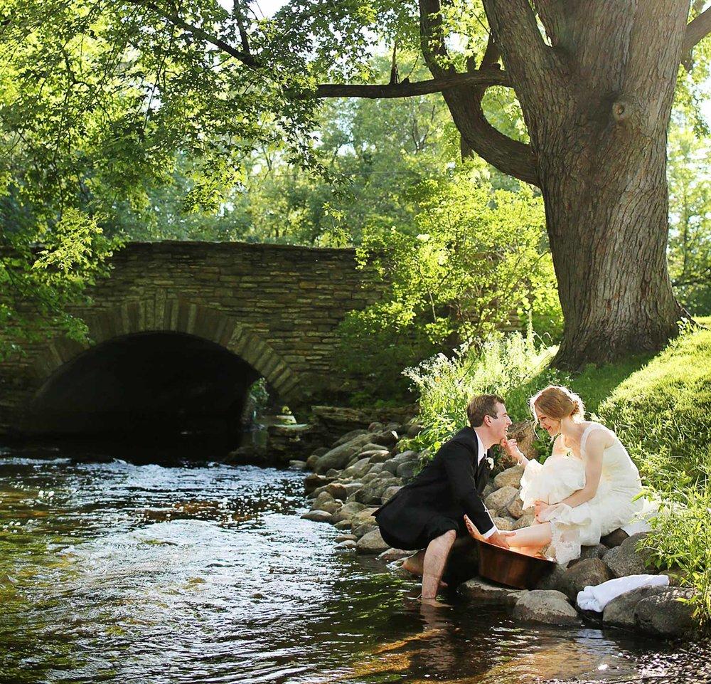 24-Edina-Minnesota-Wedding-Photographer-by-Andrew-Vick-Photography-Summer-Bride-Groom-Ceremonial-Foot-Washing-Creek-Betsy-and-Jon.jpg