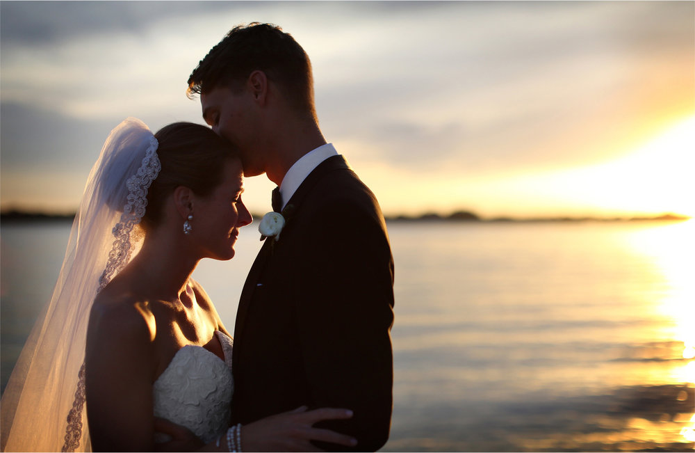 12-White-Bear-Lake-Minnesota-Wedding-Photographer-by-Andrew-Vick-Photography-Summer-Yacht-Club-Bride-Groom-Kiss-Sunset-Hallie-and-Ted.jpg