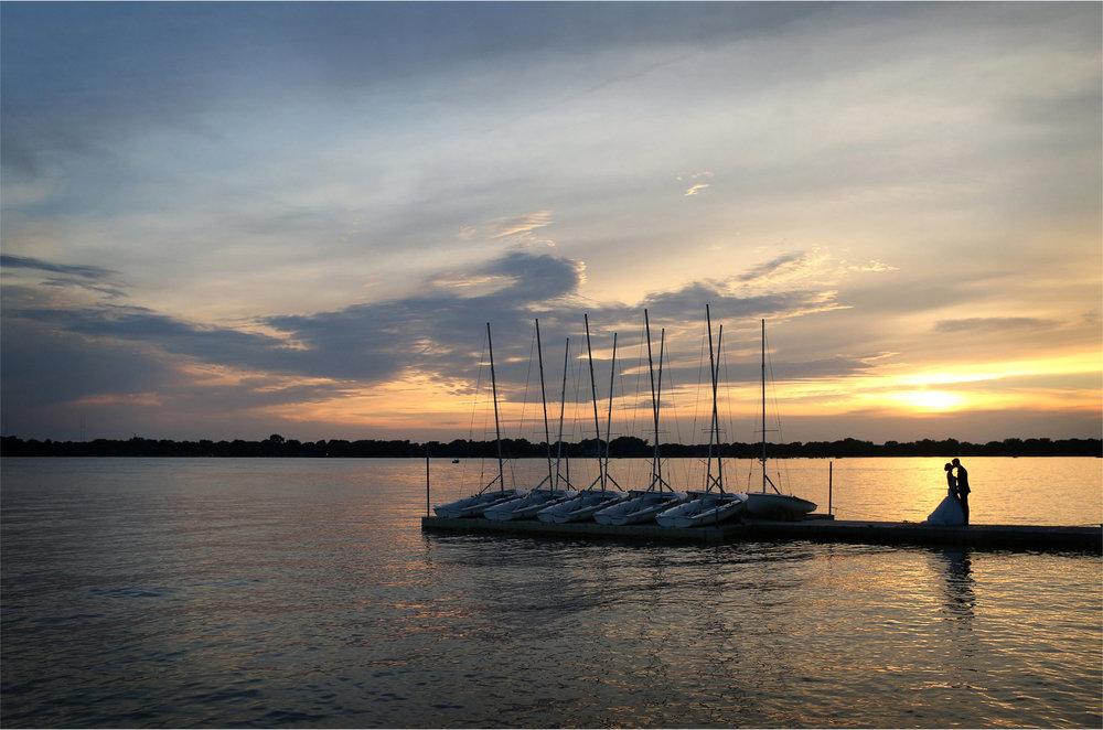 15-White-Bear-Lake-Minnesota-Wedding-Photographer-by-Andrew-Vick-Photography-Summer-Yacht-Club-Bride-Groom-Kiss-Docks-Sailboats-Boats-Sunset-Hallie-and-Ted.jpg
