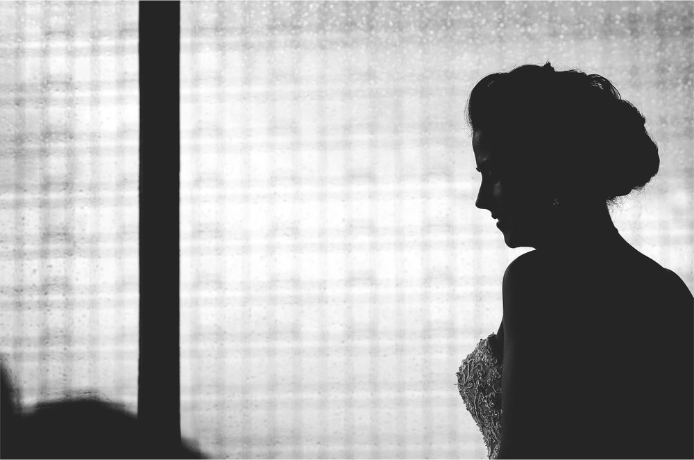 02-Minneapolis-Minnesota-Wedding-Photographer-by-Andrew-Vick-Photography-Summer-Loews-Hotel-Bride-Getting-Ready-Dress-Black-and-White-Lindsay-and-Dustin.jpg