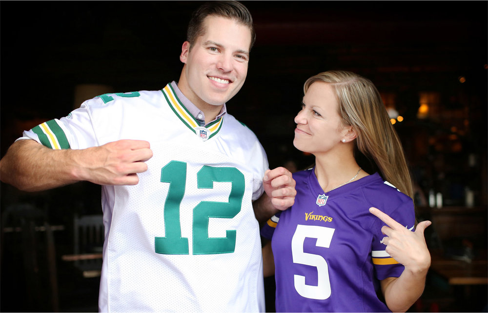 08-Minneapolis-Minnesota-Engagement-Photographer-by-Andrew-Vick-Photography-Summer-Saint-Anthony-Main-Aster-Cafe-Vikings-Green-Bay-Packers-Jerseys-Football-Excitement-Tina-and-Kevin.jpg