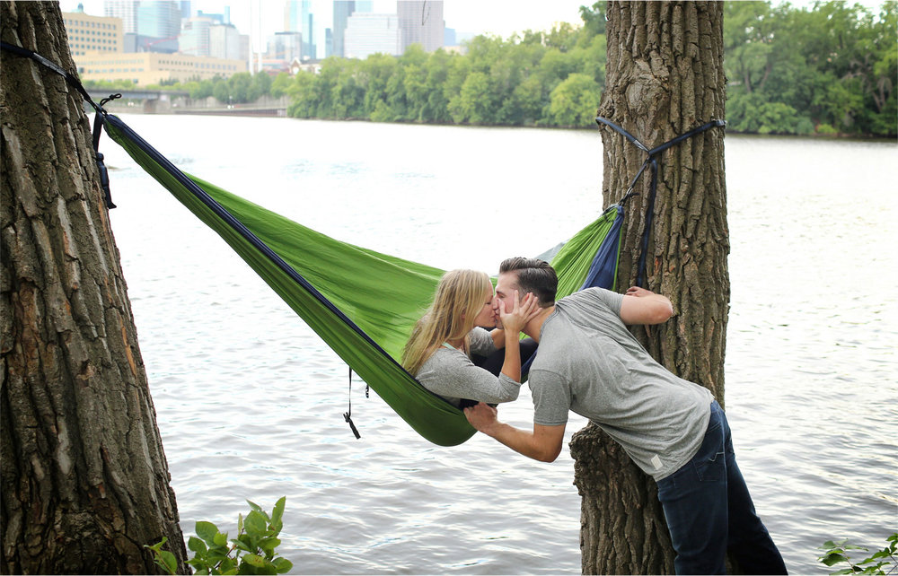 10-Minneapolis-Minnesota-Engagement-Photographer-by-Andrew-Vick-Photography-Summer-Mississippi-River-Hammock-Kiss-Tina-and-Kevin.jpg